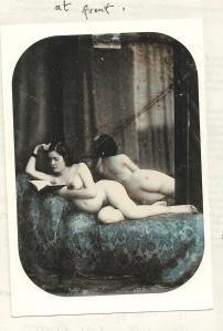 Dorothy on a dark bed, reading